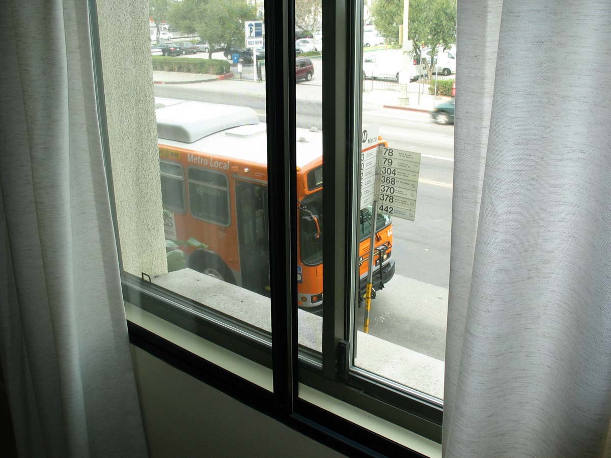 The bus stops right outside the window in this unit.