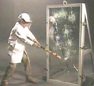 Breaking laminated glass